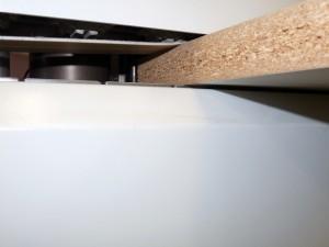 Highflex 1440: Presión de la parte superior de la pieza mediante una correa en V.